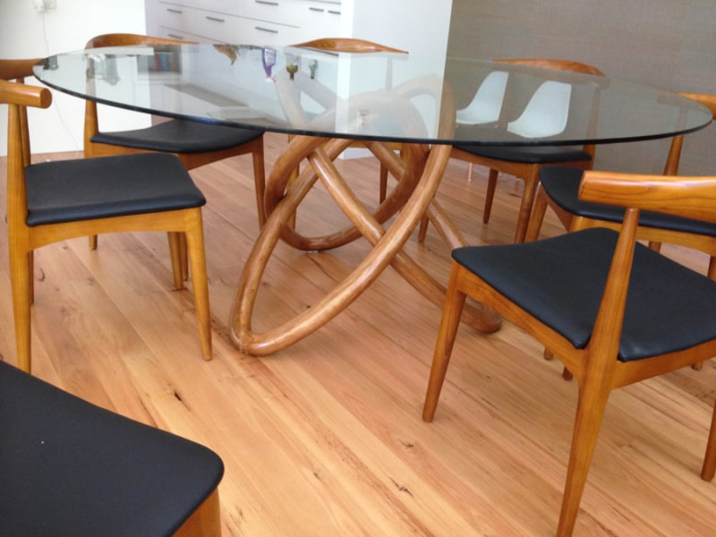 Glass top table with curved legs