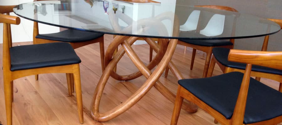 Glass top table with oval legs